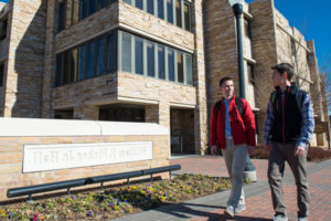 students walking in front of fisher south residence hall