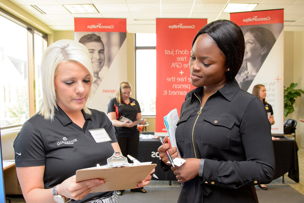 Student and counselor at a job fair