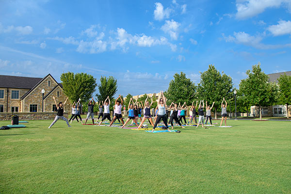 "a group doing yoga on the ""u"""